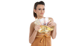 Woman with purse full of cash Royalty Free Stock Photos
