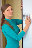 Woman push button digital thermostat Royalty Free Stock Photo