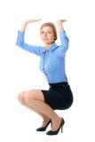 Woman push something up, isolated on white Royalty Free Stock Images
