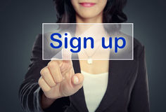 Woman push to Sign Up button. On virtual screen stock images