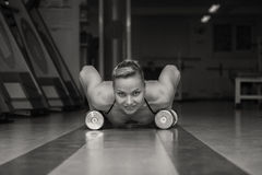 Woman push-ups on the floor Royalty Free Stock Photography