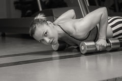 Woman push-ups on the floor Stock Images