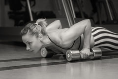 Woman push-ups on the floor Royalty Free Stock Image