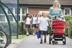A woman with a pushchair with her son Royalty Free Stock Photos