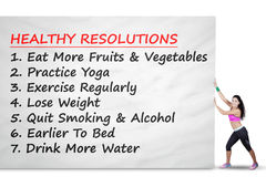 Woman pushes banner with healthy resolutions Stock Image