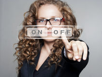 """Woman pushing the """"off"""" button Royalty Free Stock Images"""