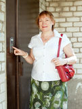 Woman pushing button of house intercom Royalty Free Stock Photos