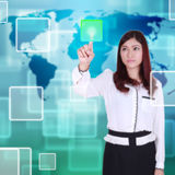 Woman pushing button on a touch screen Stock Image