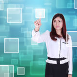 Woman pushing button on a touch screen Royalty Free Stock Images