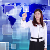 Woman pushing button on a touch screen Stock Images