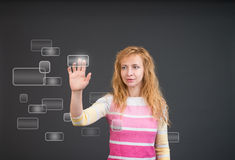 Woman pushing a button on a touch screen interface stock photography
