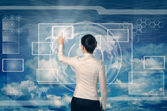 Woman pushing button in web interface. Business woman pushing virtual button in web interface with her finger over blue sky Stock Image