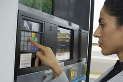 Woman Pushing Buttons On Fuel Pump Royalty Free Stock Image