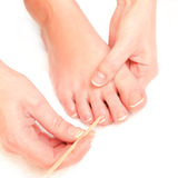 Woman pushing cuticles toes Royalty Free Stock Images
