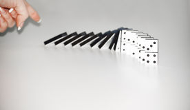Woman pushing dominoes Stock Photography