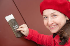 Woman pushing a door bell button Stock Images