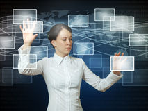 Woman pushing icons in web interface Stock Photography