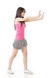 Woman pushing or leaning on wall Stock Images