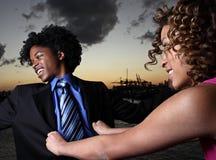 Woman pushing a man Stock Photos