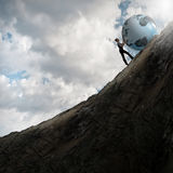 Woman pushing planet Royalty Free Stock Photography