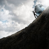 Woman pushing planet Royalty Free Stock Images