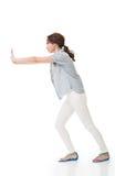 Woman pushing Royalty Free Stock Photo