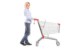Woman pushing a shopping cart Stock Photography
