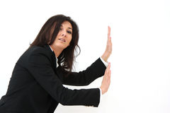 Woman pushing something Royalty Free Stock Photos