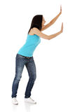 Woman pushing something imaginary Stock Photos