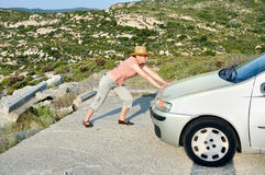 Woman pushing and trying to stop the car Royalty Free Stock Photo