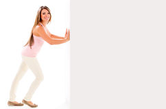 Woman pushing a wall Royalty Free Stock Photography