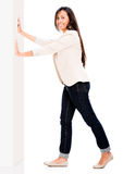 Woman pushing the wall Royalty Free Stock Photography