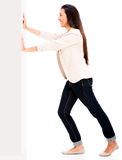 Woman pushing a wall Stock Photo