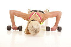 Woman pushup on weights down Stock Images