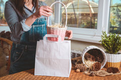 Woman put basket in pocketas a gift Royalty Free Stock Photo