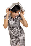 Woman Put Book on Head Royalty Free Stock Image