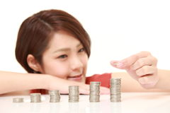 Woman put coins to stack of coins Royalty Free Stock Photo
