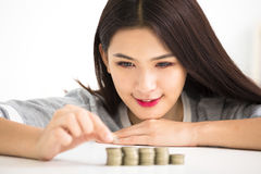 Woman put coins to stack , Saving money concept Royalty Free Stock Images