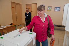Woman put election ballot with candidates for the Mayor of Mosco Royalty Free Stock Image