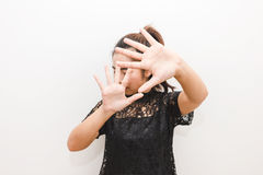 The woman put her hands up in defense afraid of something.  Royalty Free Stock Images