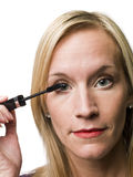 Woman put on make up Royalty Free Stock Photography