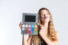 Woman put make-up and having fun Royalty Free Stock Images