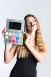 Woman put make-up and having fun Stock Photography