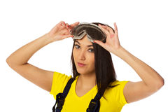 Woman put on safety goggles. Royalty Free Stock Photography