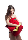 Woman put towel in red beach bag isolated Royalty Free Stock Photos