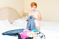 Woman puts clothes in suitcase. Stock Photography