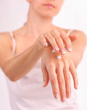 Woman puts a cream for beautiful hands Stock Image