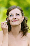 Woman puts on her face powder brush Royalty Free Stock Images