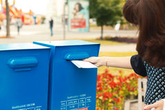 Woman puts letters in the mailbox Royalty Free Stock Images