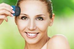Woman puts makeup Royalty Free Stock Photos